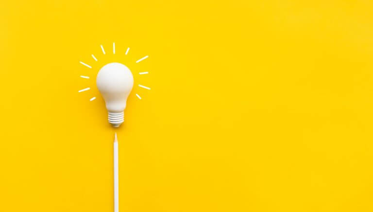 Decorative: White Light Bulb on Yellow